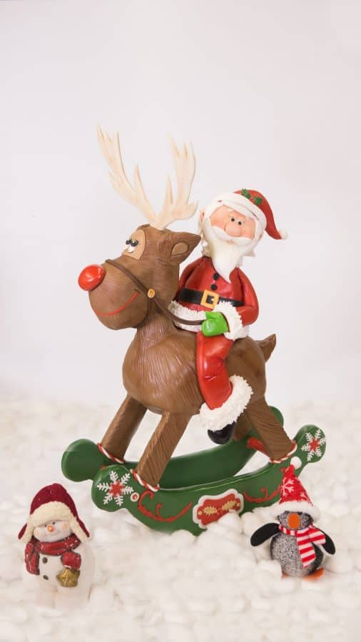 A cake sculpted to look like Santa Claus on a reindeer.