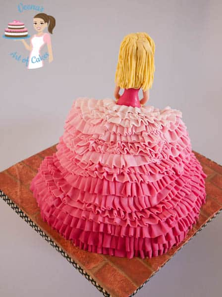 A cake decorated to look like a princess.