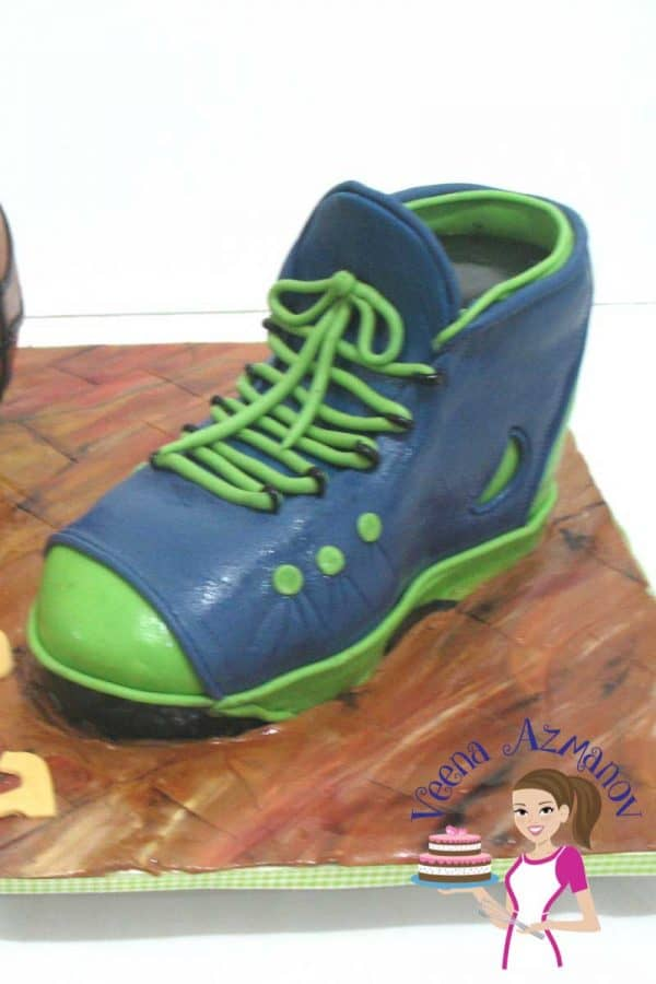 A sports shoe cake is a great gift for a boy or man. No matter what the age; men will always be boys when it comes to sports. This is a simple beginners tutorial on how to make a simple sports shoe cake with limitless options to explore further.