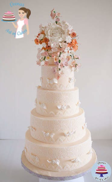 A decorated wedding cake with sugar flowers.