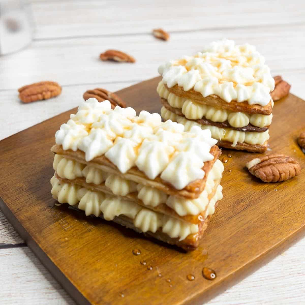 Two Mille Feuille on a wooden board