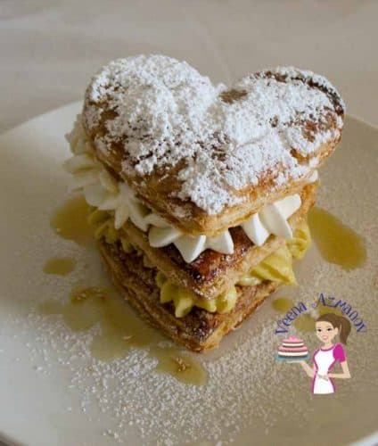 A perfect Napoleon also called Mille Feuille is about getting the puff pastry to cook just right. Golden brown and crispy not burnt and crack not collapse.