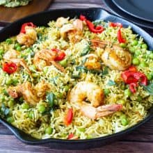 Skillet with cooked rice and prawns.