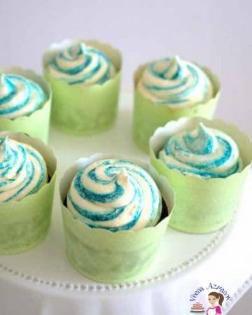 Cupcakes decorated with colorful swirls.