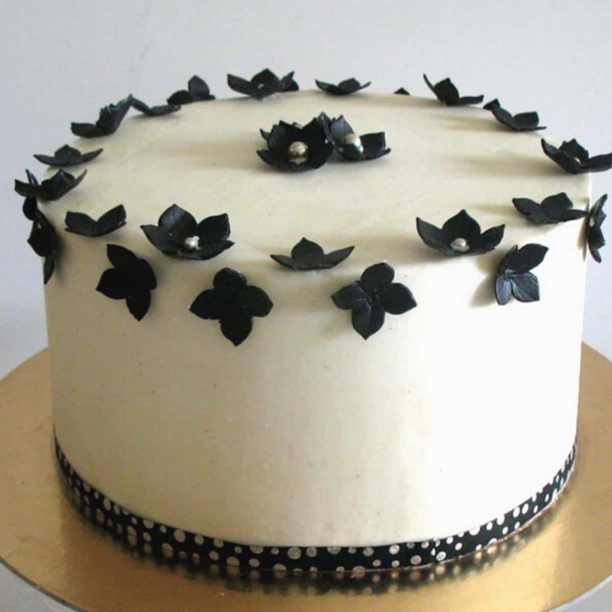 A buttercream frosted cake with sharp edges.