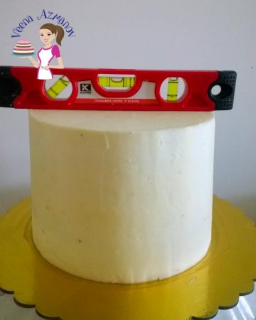 A leveler on top of a cake.