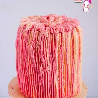 A cake decorated with buttercream frosting.