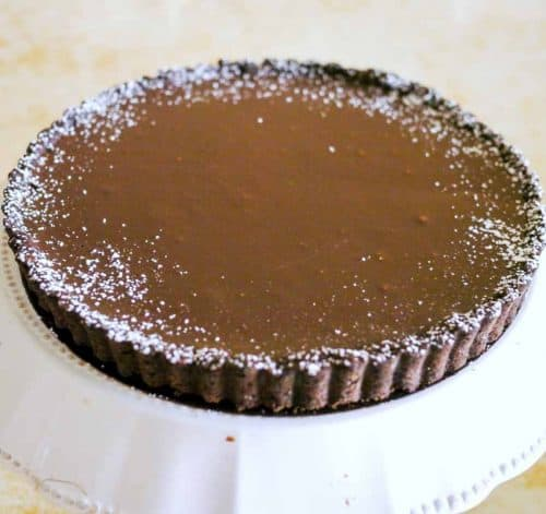 A chocolate ganache tart is probably one of the simplest easiest and effortless desserts you can put together in a few minutes. The only effort is usually the crust which again can be sourced is you do not want to make from scratch.
