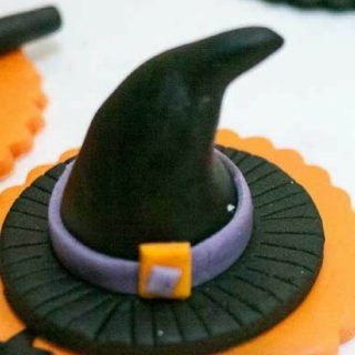 A Witch's Hat Cupcake topper is a simple and easiest sweet treat  you can make in less than five minutes and  ball of back fondant in your hands for this Halloween. Kids love their cupcakes topped with anything witchy - right?