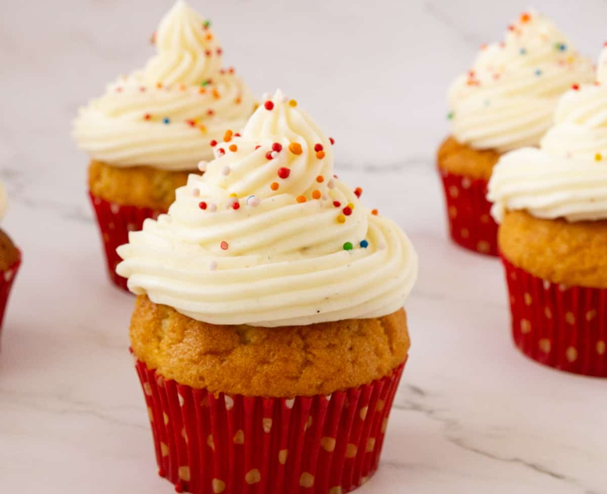Frosted vanilla cupcakes.