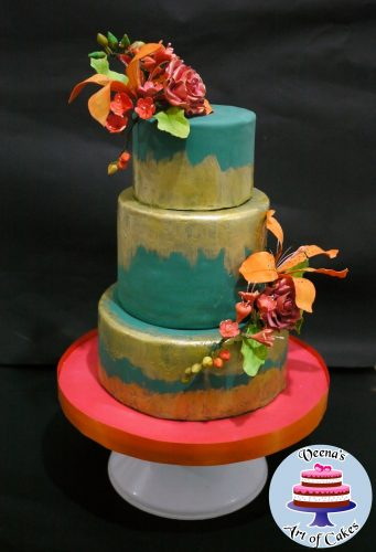 A decorated cake with sugar flowers.