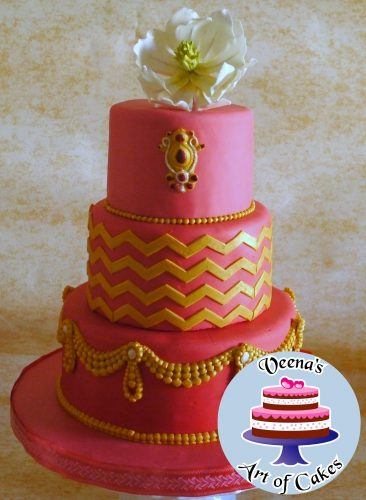 A red ombre swag decorated cake.
