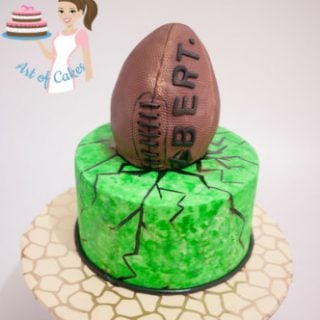 A cake decorated to look like a football.