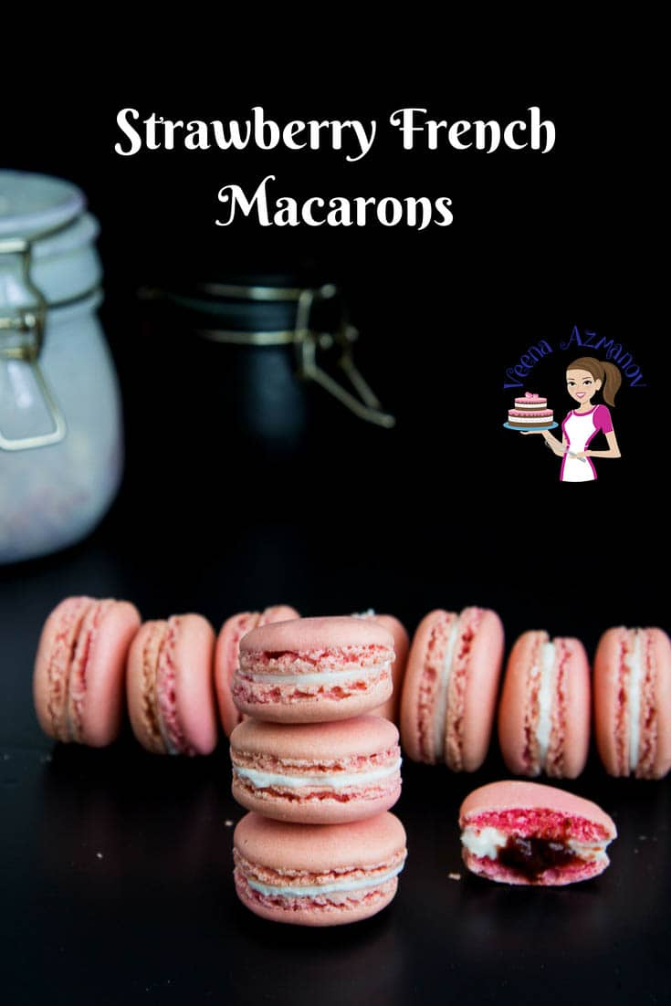 A Pinterest Optimized image for Strawberry French Macarons filled with Swiss Meringue Buttercream and Strawberry Jam.