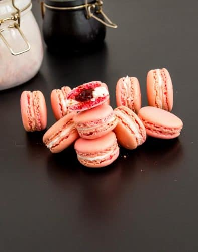 These strawberry French macarons are light meringue-based cookies that will melt in your mouth. Soft chewy on the inside with a crisp shell on the outside. This simple, easy and effortless recipe with my full proof method will guarantee you success over and over again. Made with almond meal and strawberry flavor these are filled with Swiss meringue buttercream and strawberry jam today.