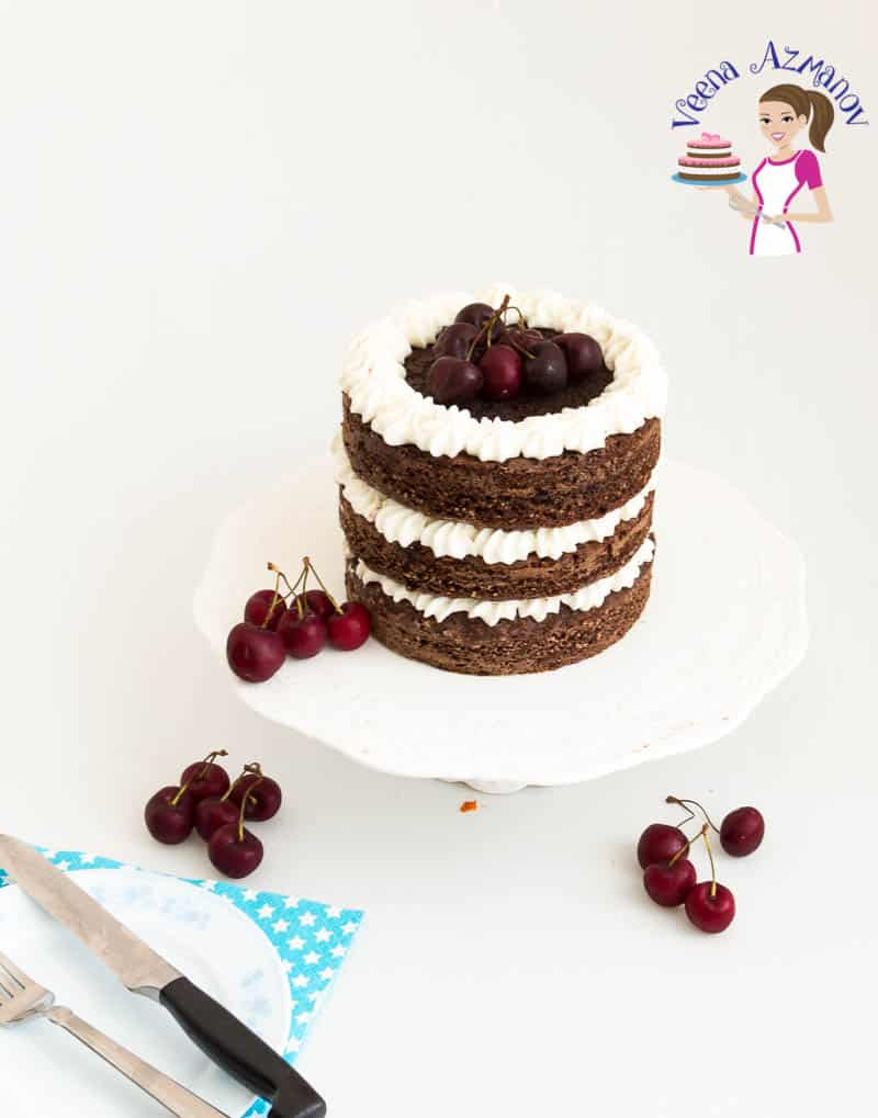 A Pinterest optimized image for one bowl chocolate cake made featuring the chocolate cake with American Buttercream and decorated with cherries
