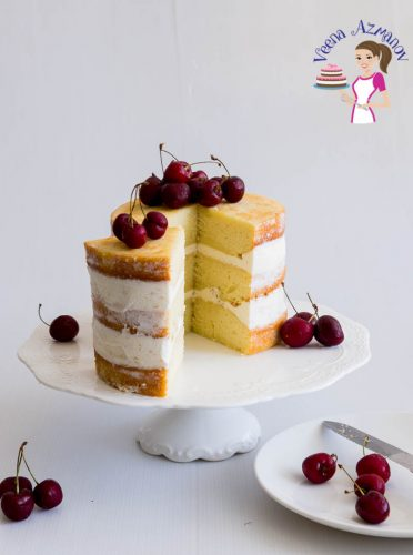 A Pinterest optimized image for one bowl vanilla cake recipe featuring a three layer vanilla cake frosted with American Buttercream and topped with fresh cherries
