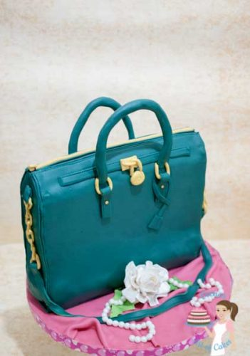 Teal Biz Handbag - A Hand bag cake is a perfect cake to make for a lady of any age. Depending on the age you can tweak the colors, accessories and style. Great Tutorial on the Pink Handbag Cake by Veena Azmanov of Veena's Art of Cakes
