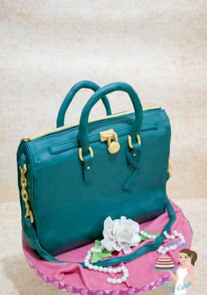 A cake sculpted to look like a handbag.