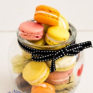 An assortment of macarons in a jar.