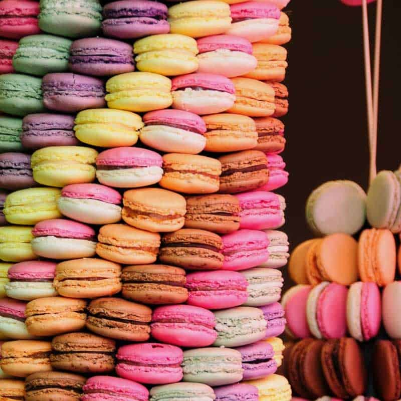 A large stack of macarons in different colors.