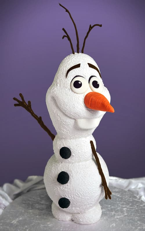 A cake decorated to look like Olaf from the movie Frozen.