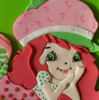 A Fondant Picture Transfer is a great technique to add edible fondant images onto your cake. This simple, easy and effortless tutorial will show you how to create this strawberry shortcake image for your next cake but the technique can be used with most other images or characters as well.