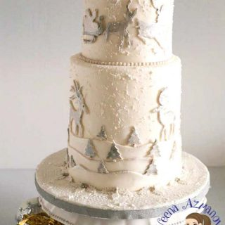 A Frosted Christmas Cake for a beautiful Christmas theme wedding with white Christmas trees, frosted snow effect. The sleigh and the snow capped mountains. All made in fondant. Here's a simple and easy tutorial.
