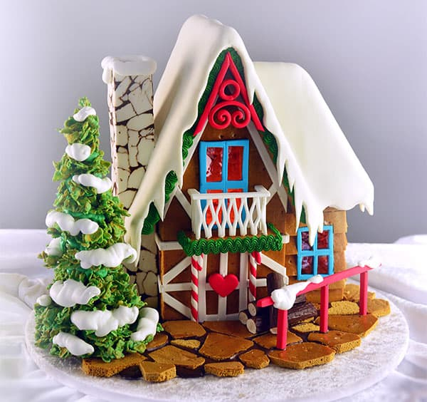 A cake decorated to look like a gingerbread house.