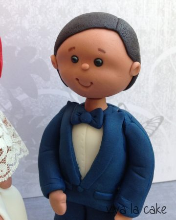 A cake topper shaped like a groom.