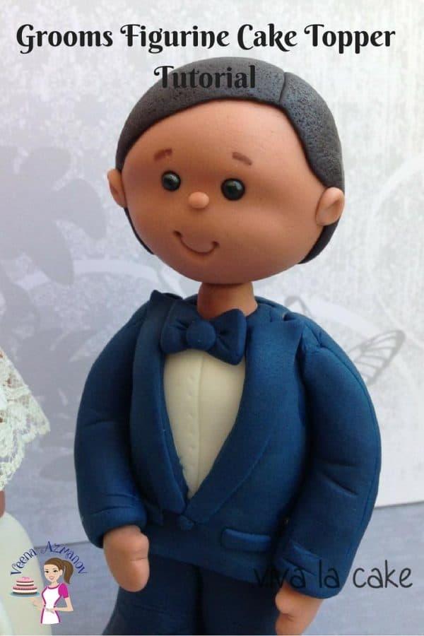 A cake topper shaped like a groom.