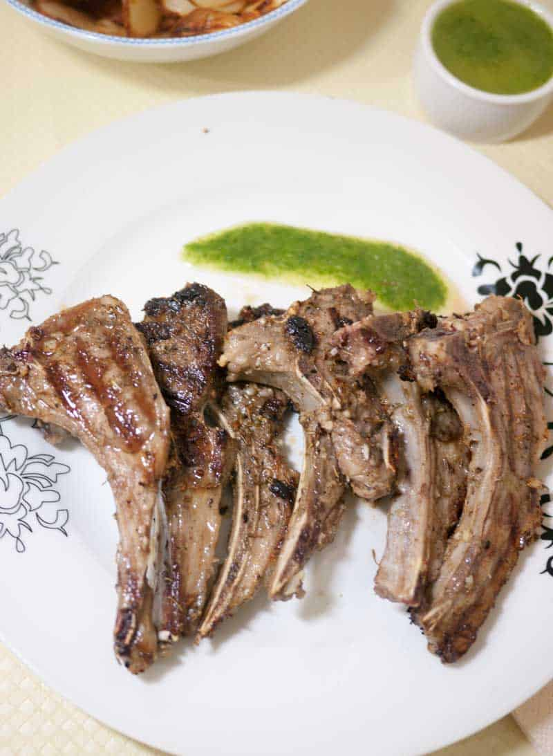 An image optimized for sharing on social media for grilled lamb chops served with cilantro mint sauce