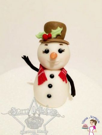 A stylish gumpaste snowman makes for a good Christmas cake topper. This simple, easy and effortless snowman tutorial is perfect way to make a cake topper for a festive Christmas inspired cake.