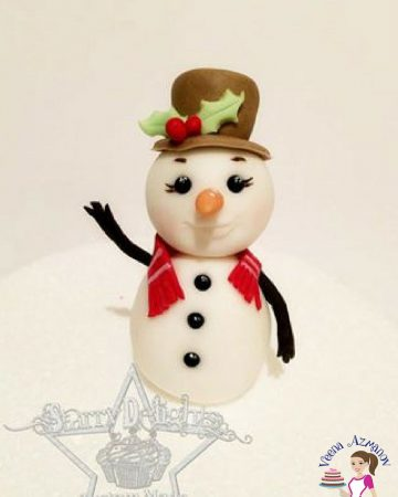 A cake decorated to look like a snowman.