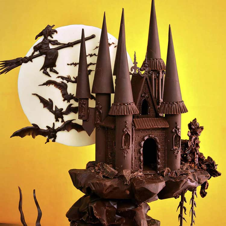 A cake decorated to look like a spooky castle.