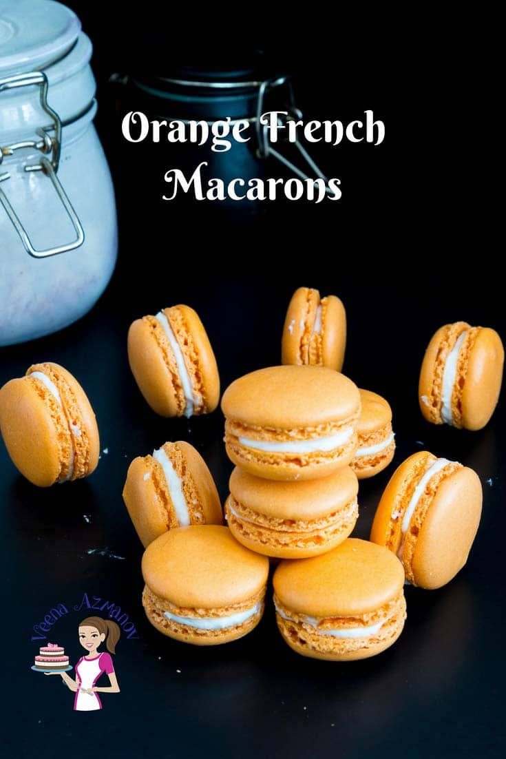 Learn to make perfect French macarons in orange flavor with this orange macaron recipe filled with orange curd and Swiss meringues #macarons #orange #recipe #nofail via @Veenaazmanov