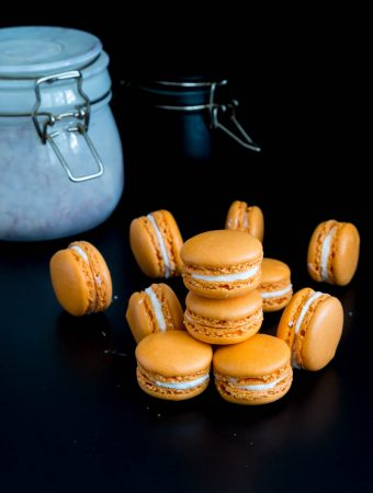 Orange French macarons are a delicacy on their own. Often filled with orange curd, marmalade, and buttercreams that almost melts in the mouth. My full proof macaron recipe is simple, easy and effortless that will have you making macarons over and over again successfully.