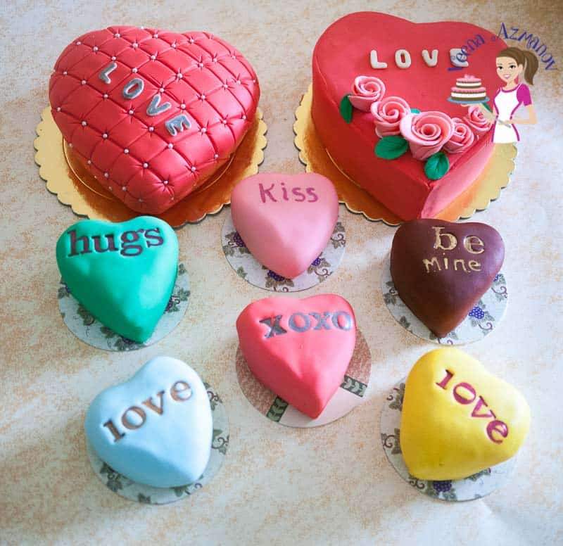 A collection of heart-shaped cakes and mini cakes.