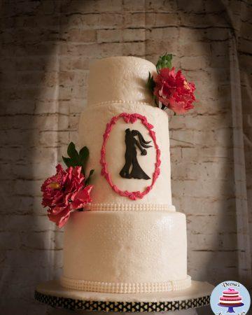 A wedding cake with sugar flowers.
