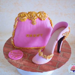A cake decorated to look like a lady's handbag and stiletto.