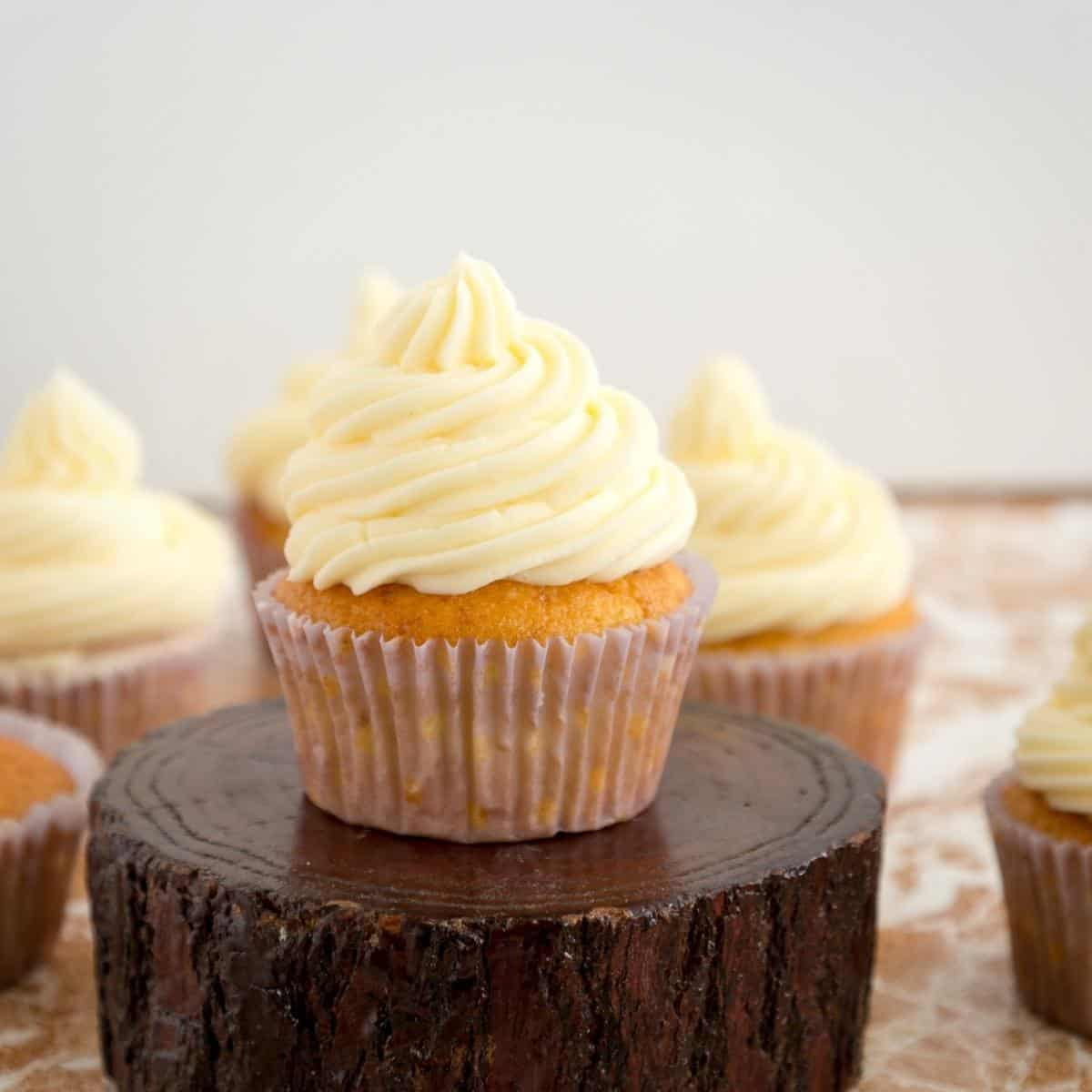 A cupcake frosted with buttercream made French method.