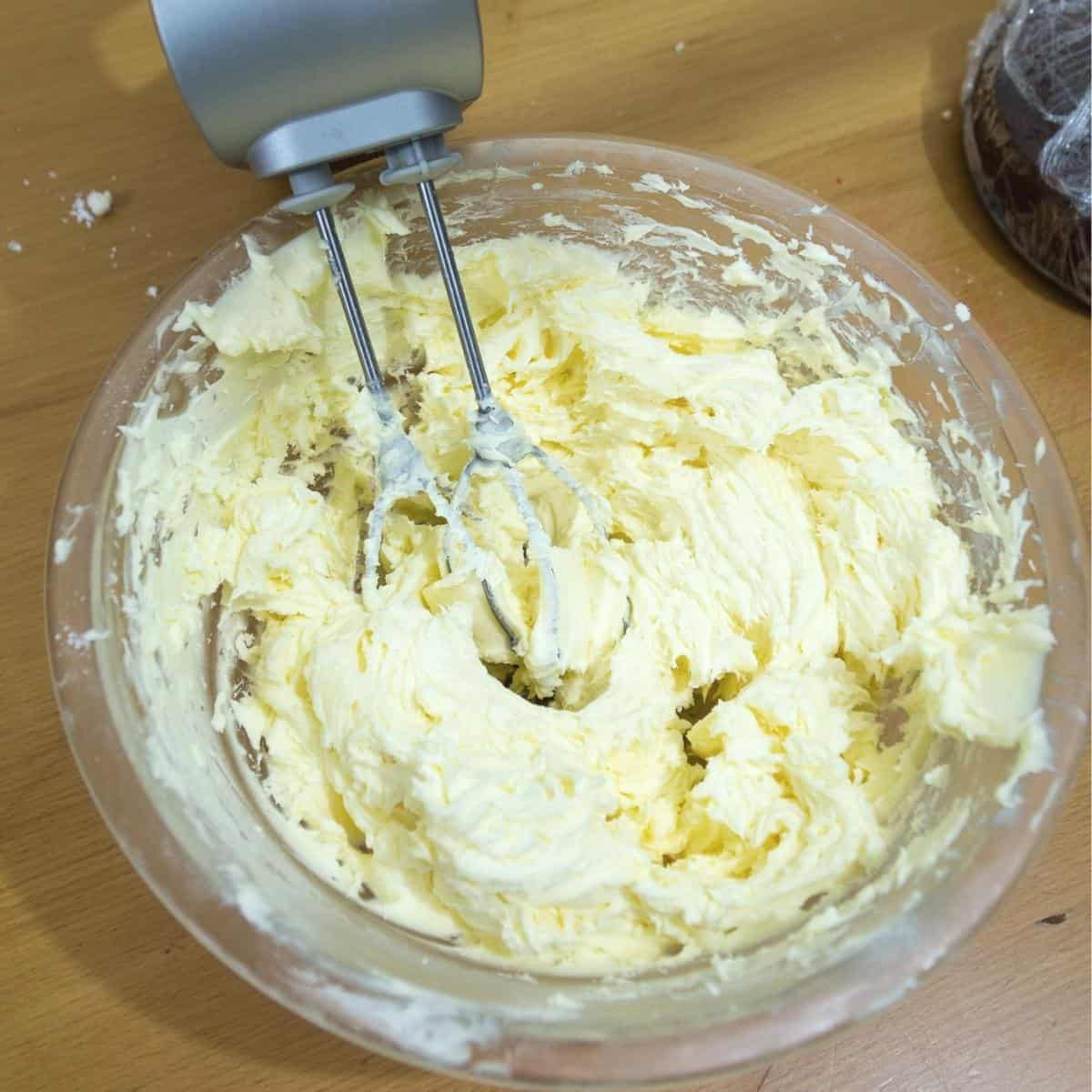 A bowl and whisk whipping buttercream.
