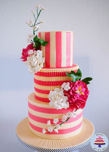 An ivory and rose pink wedding cake.