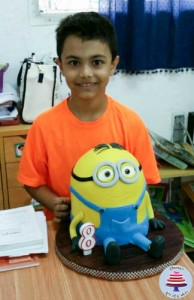A boy cake decorated to look like a minion.