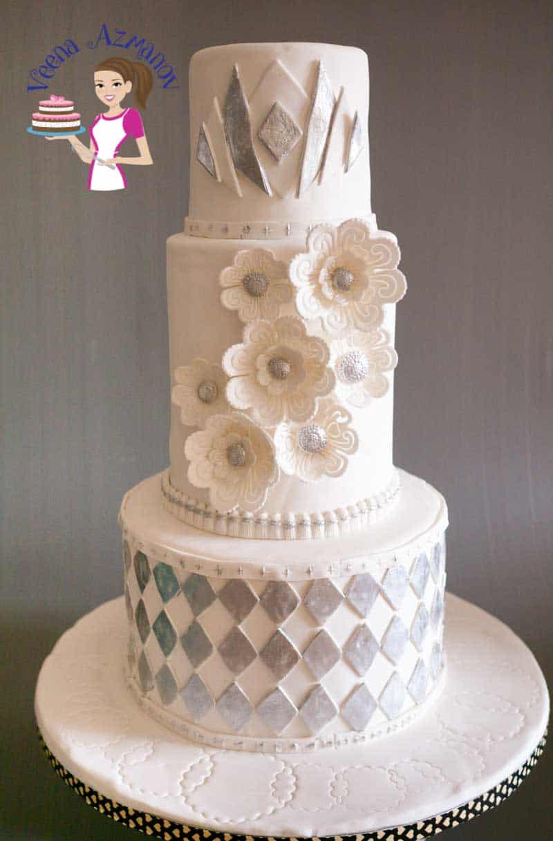 I was commissioned to make this Art Decor Theme Wedding cake recently with instructions to keep the concept of white wedding cake. Was happy with how it turned out. Here's a little info on the details of the cake.