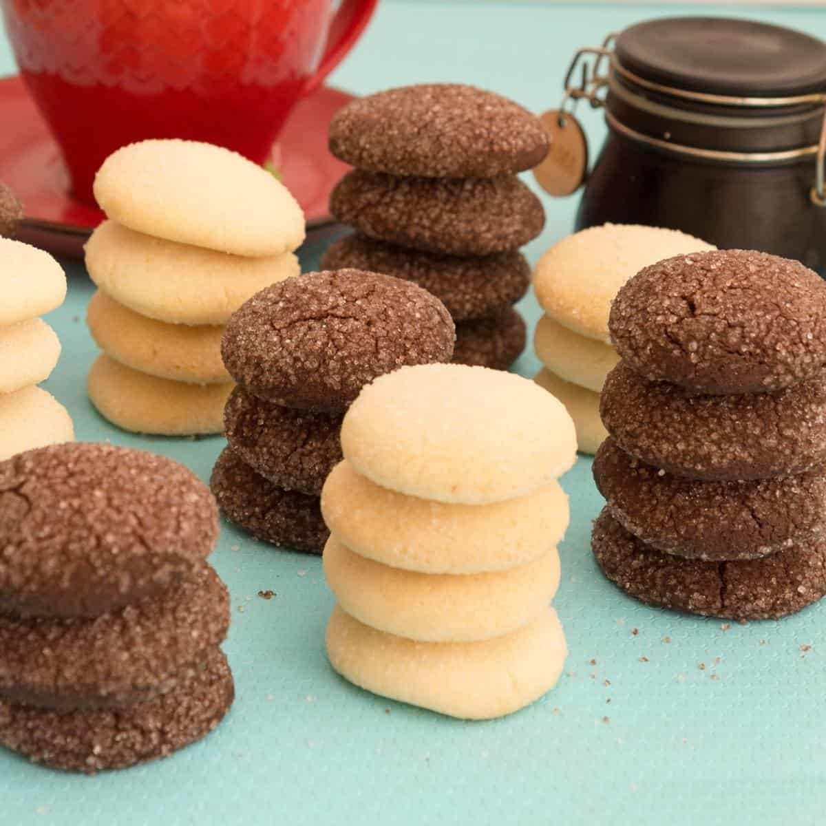 Vanilla and chocolate shortbread cookies on a blue table