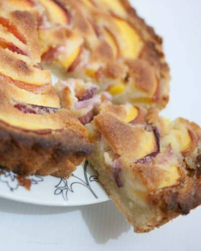 Nectarine frangipani tart is a simple easy and perfect summer dessert with seasonal nectarines or peaches. The creamy almond filling is soft, sweet and almost melts in the mouth.