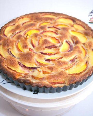 Nectarine tart on a cake stand.
