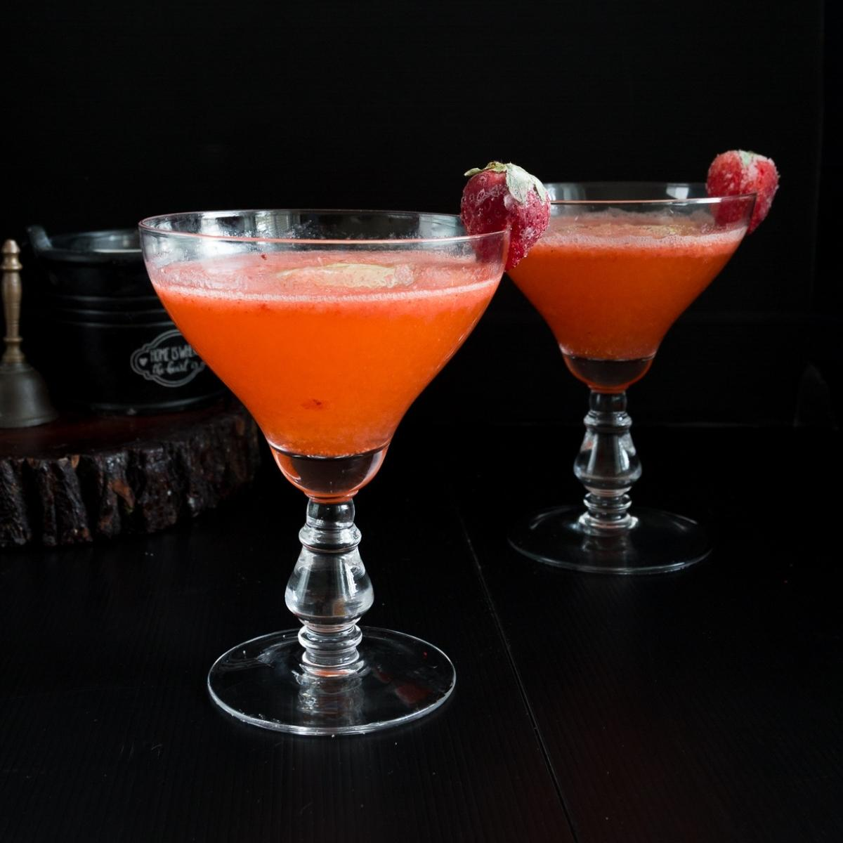 A glass of Strawberry vodka cocktail.