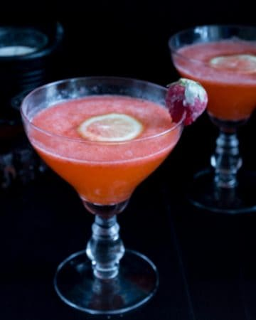A martini glass with strawberry cocktail